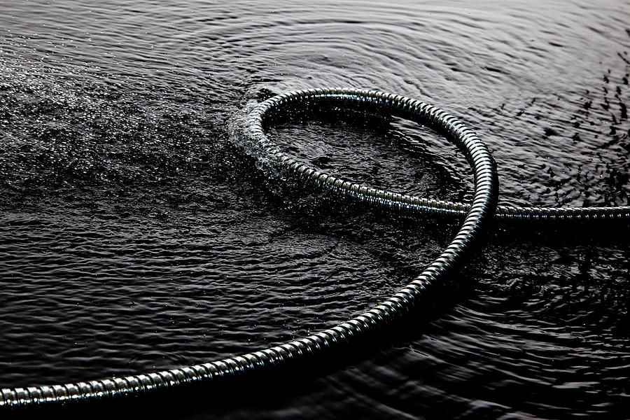 Coiled Metal Tube In Water Photograph by Walter Zerla