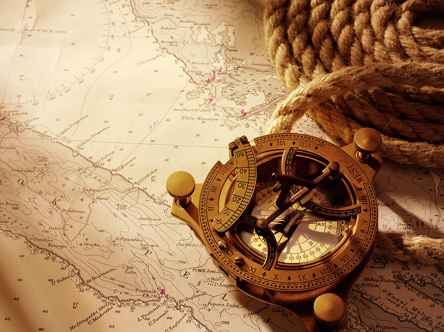 Coiled Rope And Nautical Chart With A Photograph by Wragg