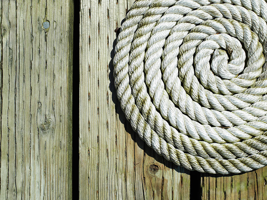 Coiled Rope On Dock Photograph by Ryan Mcvay