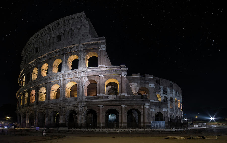 Coliseum at night by Jaroslaw Blaminsky