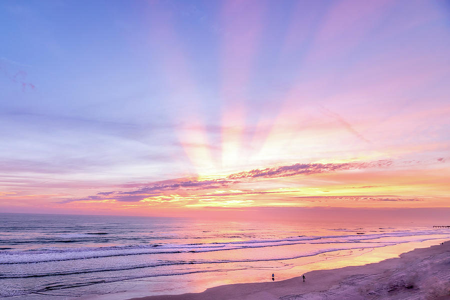 Colorful beach sunrise with sunrays shot in Fort ...