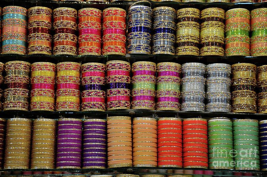 Colorful glass and metal bangles on display at shop shelf Clifton Karachi Pakistan by Imran Ahmed