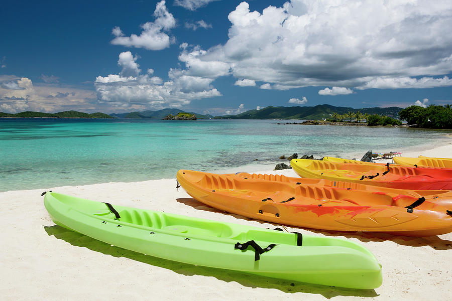 Colorful Kayaks On A Beach In The Photograph by Cdwheatley