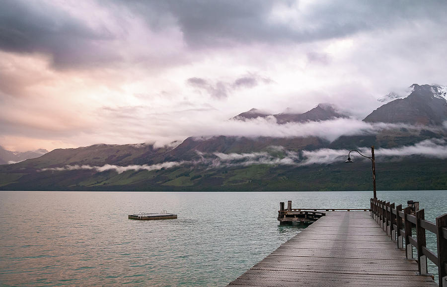 Colorful Sunset Above Wharf And Mountains In Glenorchy New Zealand by Peter Kolejak