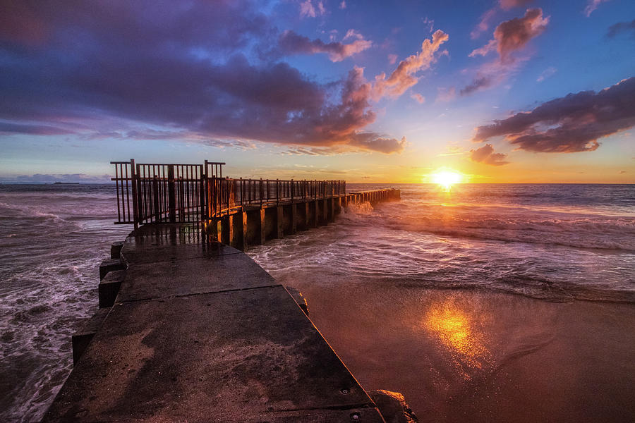 Colorful sunset at Toes Beach by Andy Konieczny