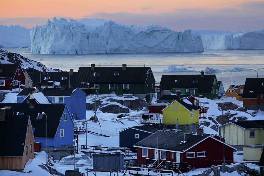 Colourful Houses And Blue Icebergs In Photograph by Timothy Allen