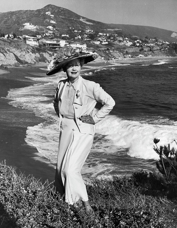 Columnist Hedda Hopper Posing On Cliff Photograph by Alfred Eisenstaedt