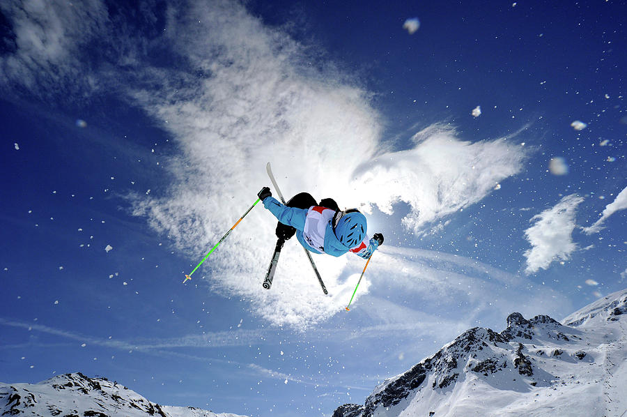 Competitive Mogul Skier Jumps Off A Photograph by Agence Zoom
