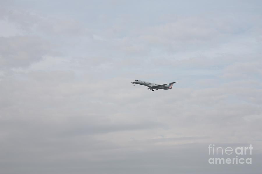 EMBRAER 145 LANDING AT LAGUARDIA AIRPORT by JOHN TELFER