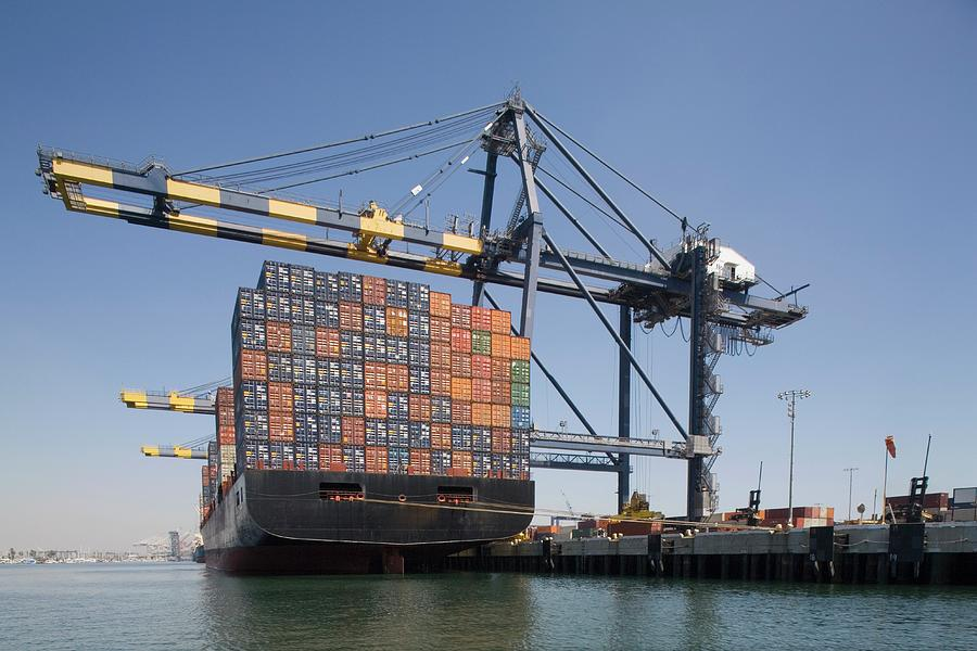Container Ship Below Cranes At A Photograph by Michael Wells