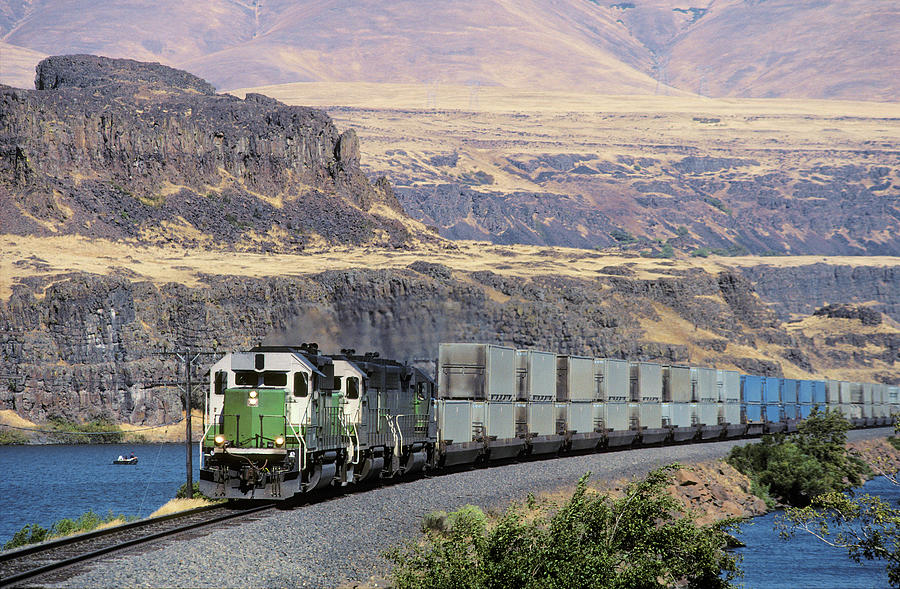 Container Trash Train In Columbia River Photograph by Beyondimages