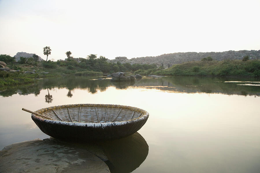 Coracle At The Bank Of A River Photograph by Exotica.im