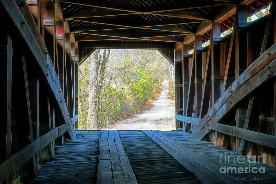 Country Road Framed by Covered Bridge Entrance by David Arment