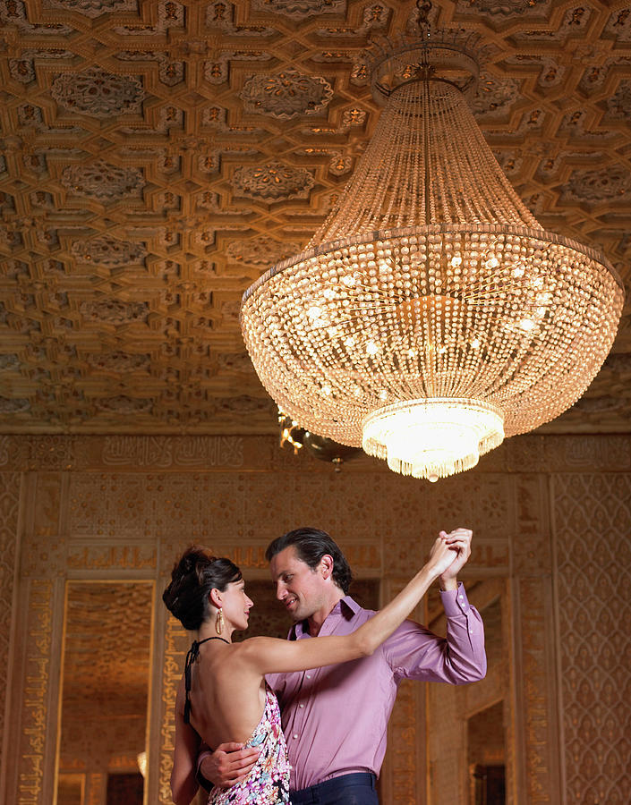 Couple Dancing Beneath Chandelier, Low Photograph by Justin Pumfrey