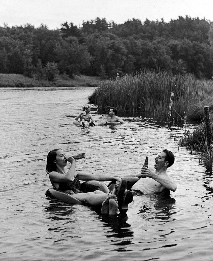 Couple Drinking Beer At Inner Tube Photograph by Alfred Eisenstaedt