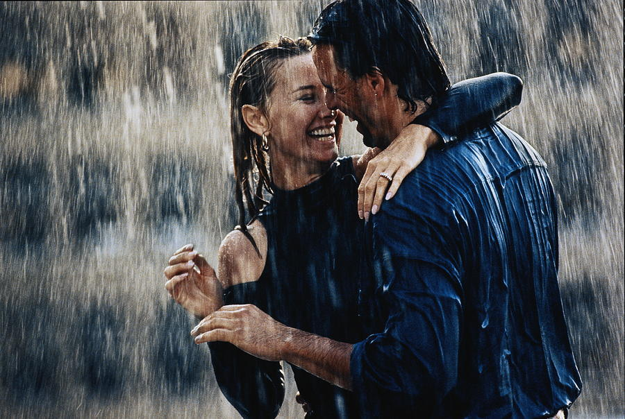 Couple Embracing In Pouring Rain Photograph by Bruce Ayres