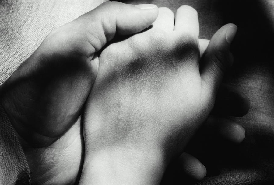 Couple Holding Hands, Close-up Of Hands Photograph by Martine Mouchy