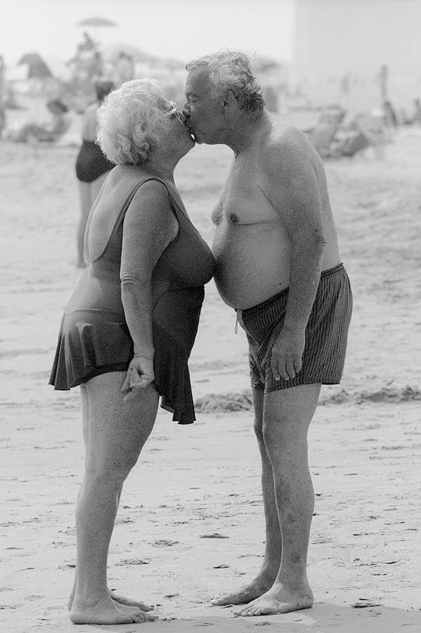 Couple Kissing On The Beach At Brighton Photograph by New York Daily News Archive