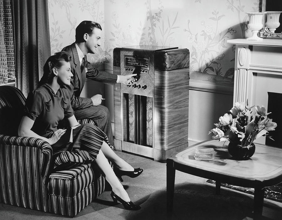 Couple Listening To Radio In Living Photograph by George Marks