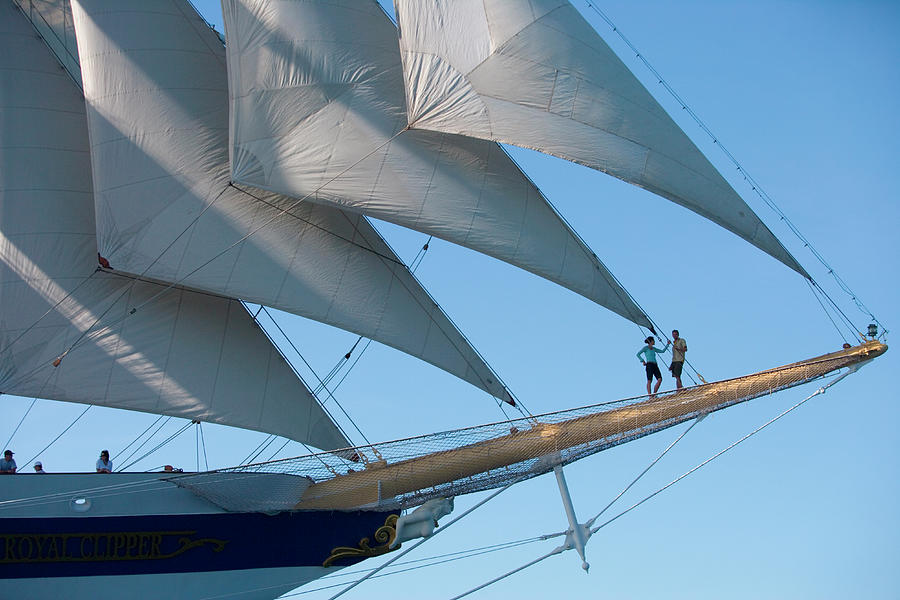 Couple On Bowsprit Of Sailing Ship Photograph by Holger Leue