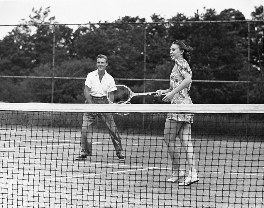 Couple Playing Tennis Photograph by George Marks