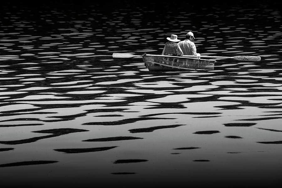 Couple rowing on Stoney Lake at Sunrise in Black and White by Randall Nyhof