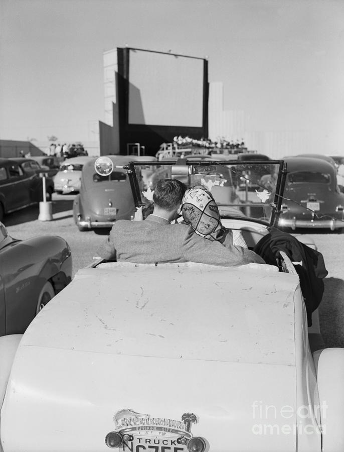 Couple Seated In Car At Drive-in Photograph by Bettmann