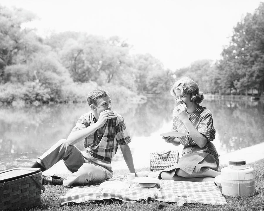 Couple Seated On Checkered Tablecloth By H Armstrong Roberts