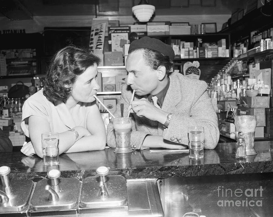 Couple Sharing Ice Cream Soda Photograph by Bettmann