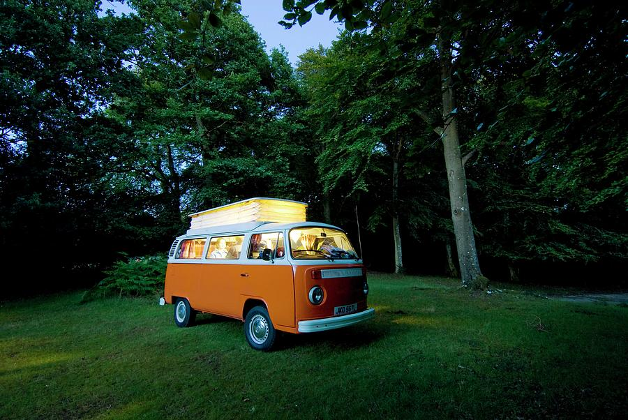 Couple Sitting In Orange Campervan At Photograph by Ian Cumming