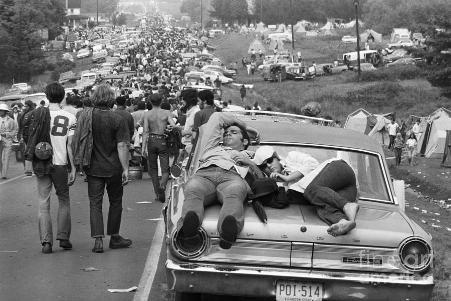 Couple Sleeping On Car At Woodstock Photograph by Bettmann