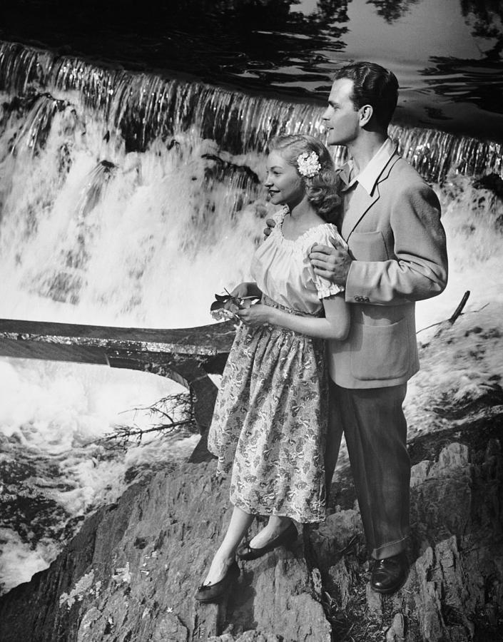 Couple Standing Near Waterfall Photograph by George Marks