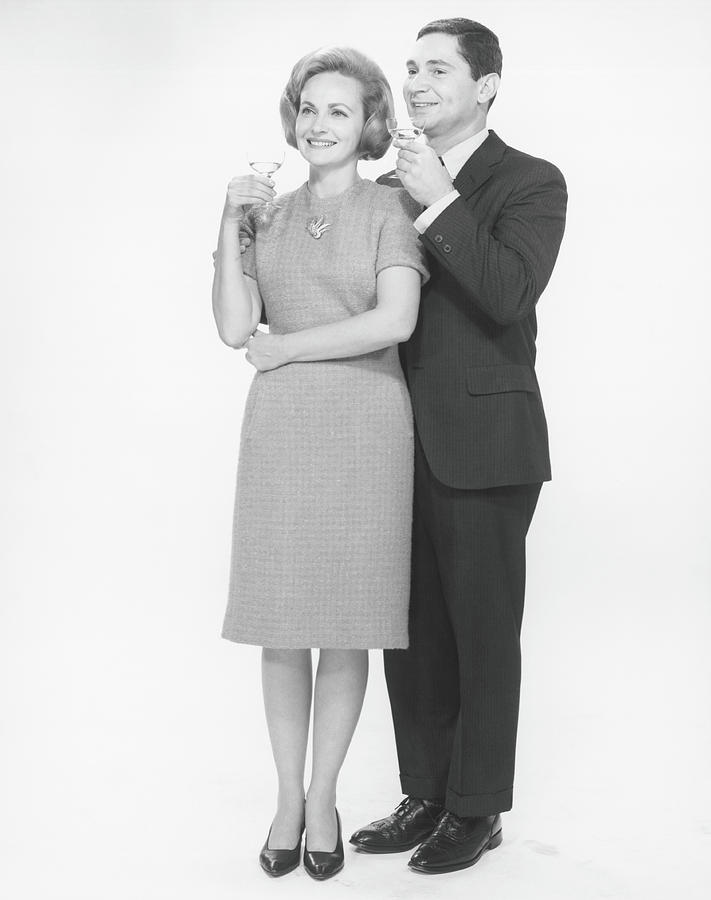 Couple Toasting Champagne In Studio, B&w Photograph by George Marks