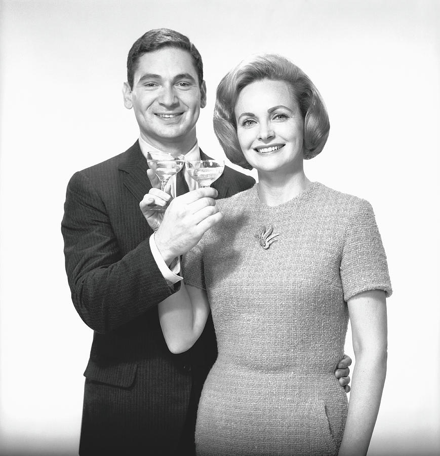 Couple Toasting Champagne In Studio Photograph by George Marks