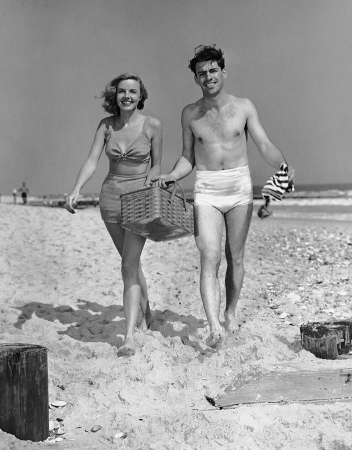 Couple Walking With Picnic Basket On Photograph by George Marks