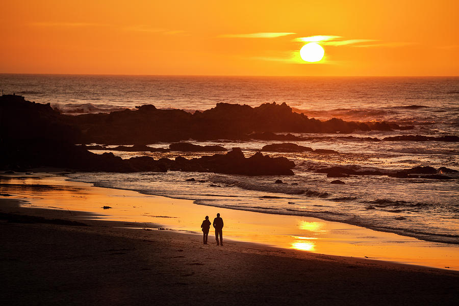 Couple Watch The Sunset At Carmel Beach Photograph by Pgiam