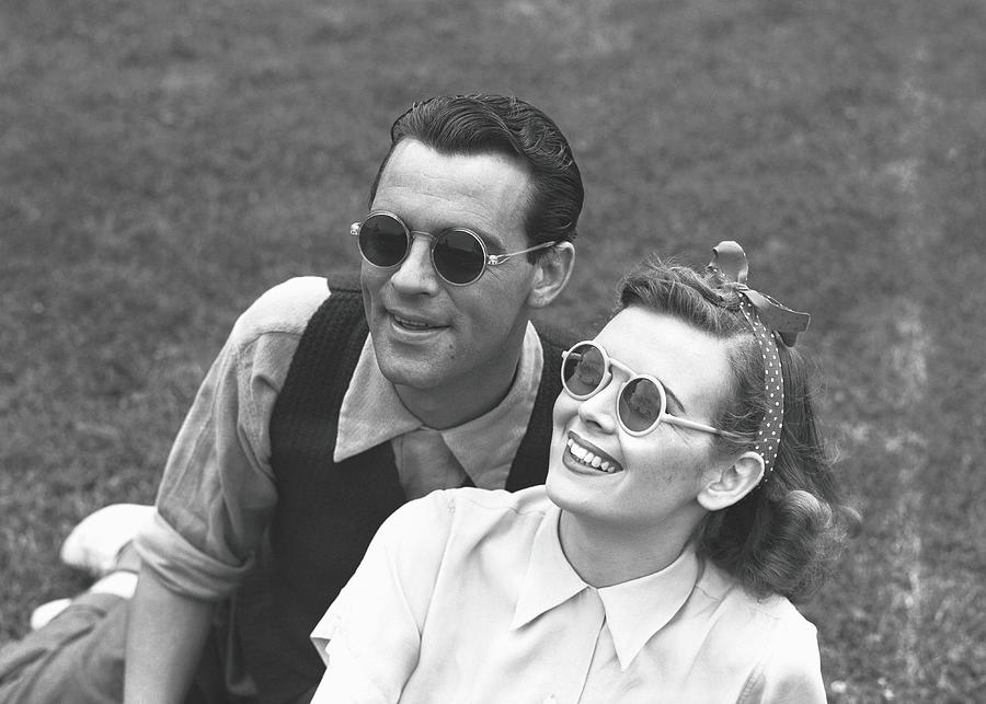 Couple Wearing Sunglasses Sitting On Photograph by George Marks