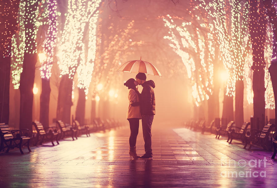 Couple Photograph - Couple With Umbrella Kissing At Night by Masson