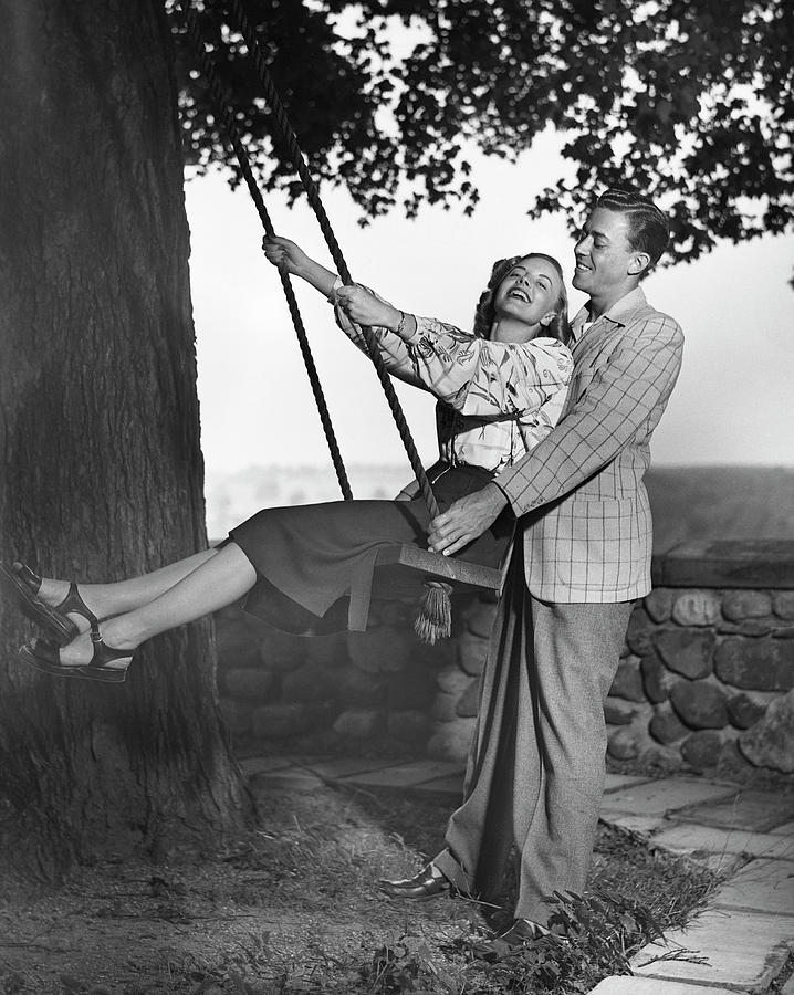 Couple Wwoman On Swing Photograph by George Marks