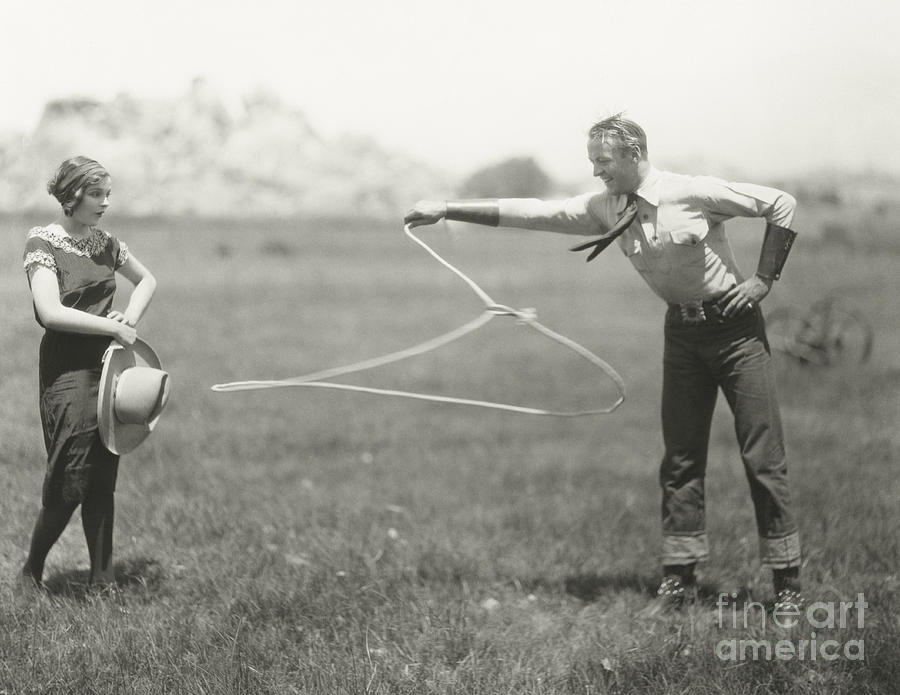 1920s Photograph - Cowboy Showing Off His Roping Skills by Everett Collection