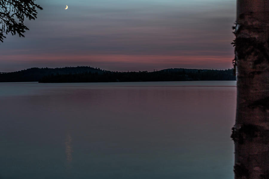Crescent moon over Dog Lake by Joe Holley