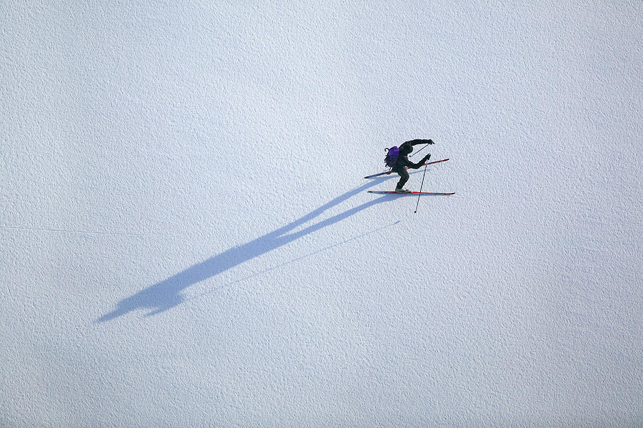 Cross-country Skier On Frozen Lake Photograph by Roine Magnusson