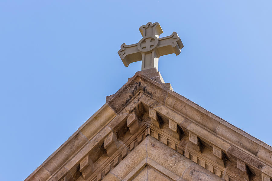 Cross on the top of St. Francis of Assisi Cathedral Basilica by Tim Stanley