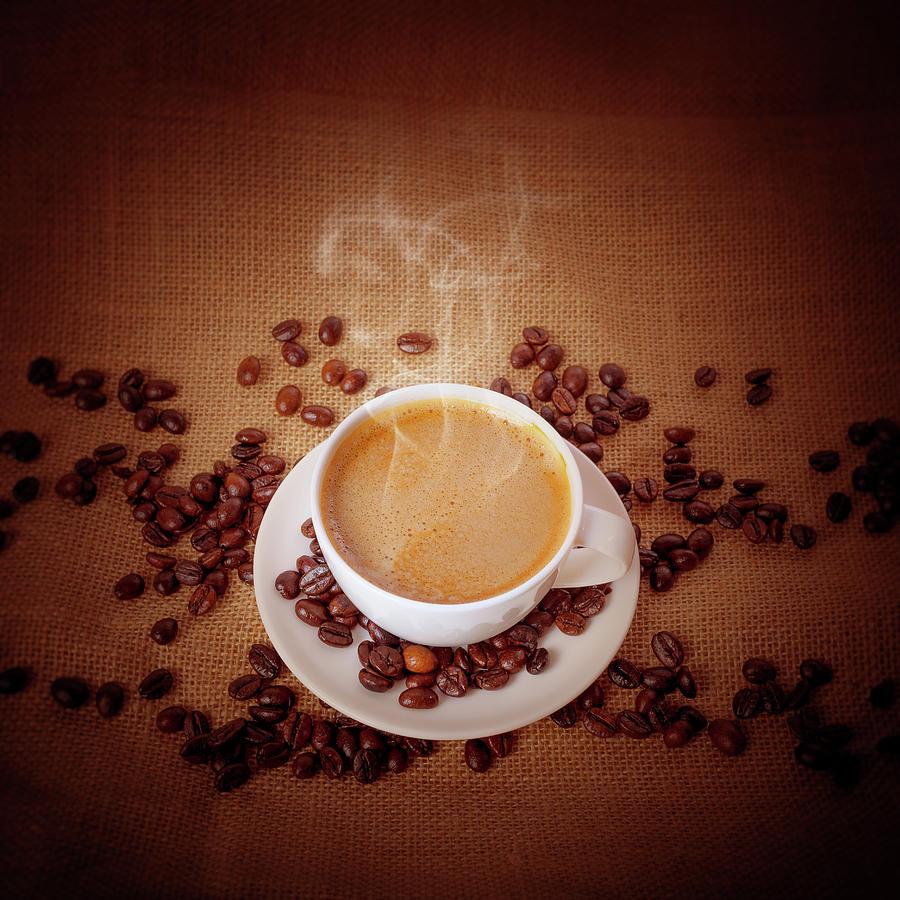 Cup Of Fresh Cappuccino On Burlap Photograph by Sankai