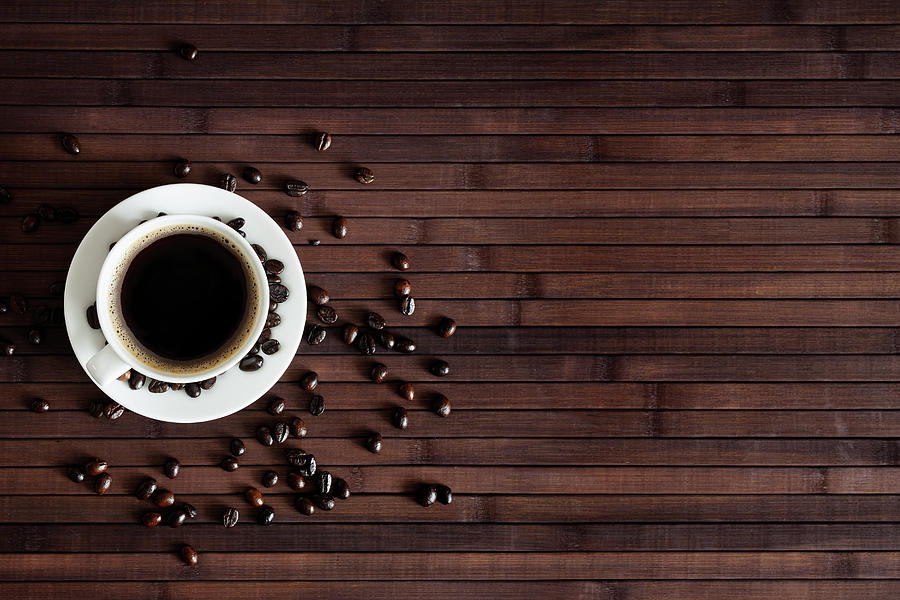 Cup Of Fresh Coffee On Dark Wood Photograph by Sankai