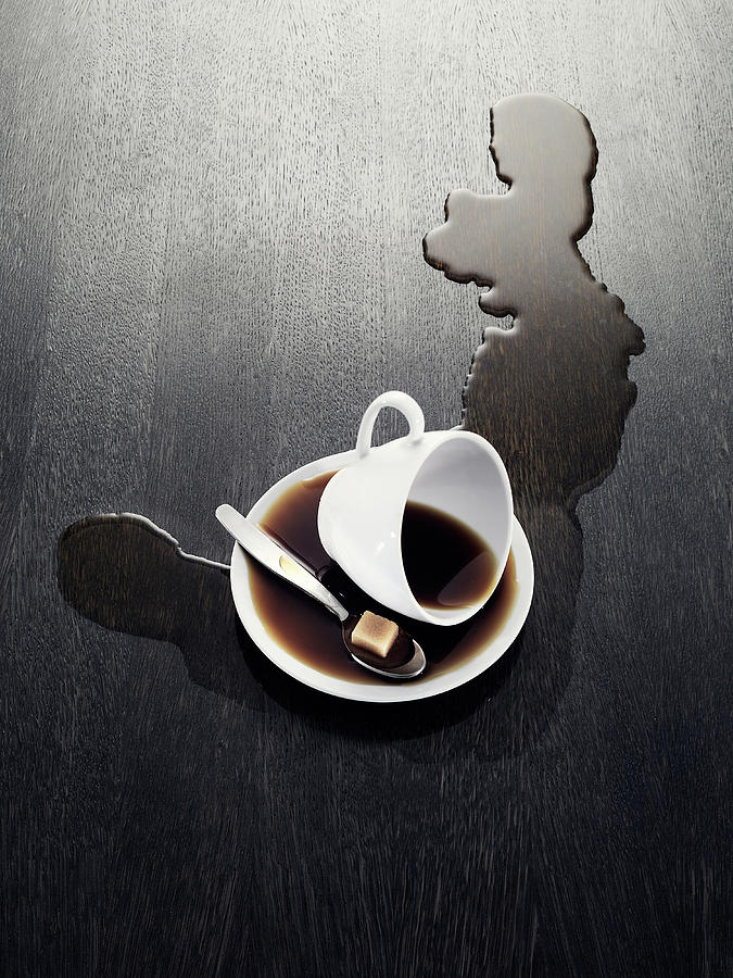 Cup With Spilled Coffee Photograph by Johner Images
