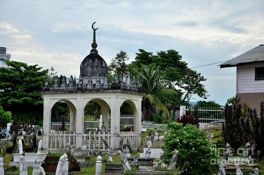 Cupola dome in Islamic Malay Muslim graveyard with many tombs Kuching Sarawak Malaysia by Imran Ahmed