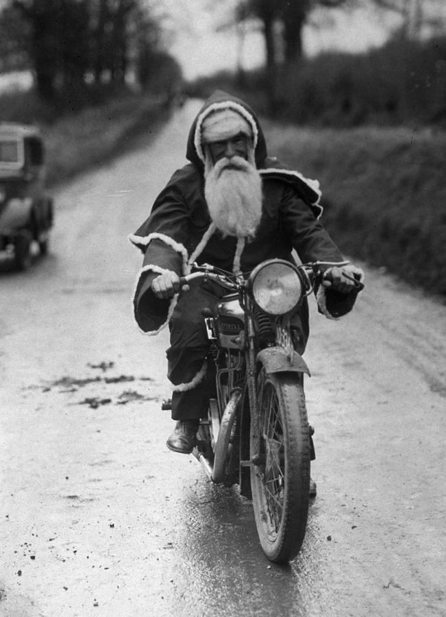 Cycling Santa Photograph by Fox Photos