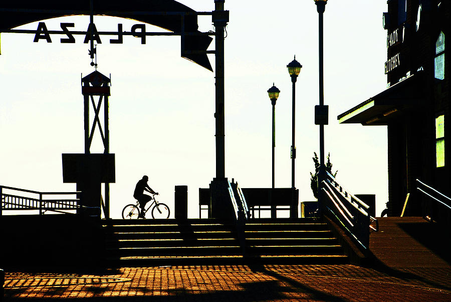 Cyclist at sunrise, Ocean City boardwalk by Bill Jonscher