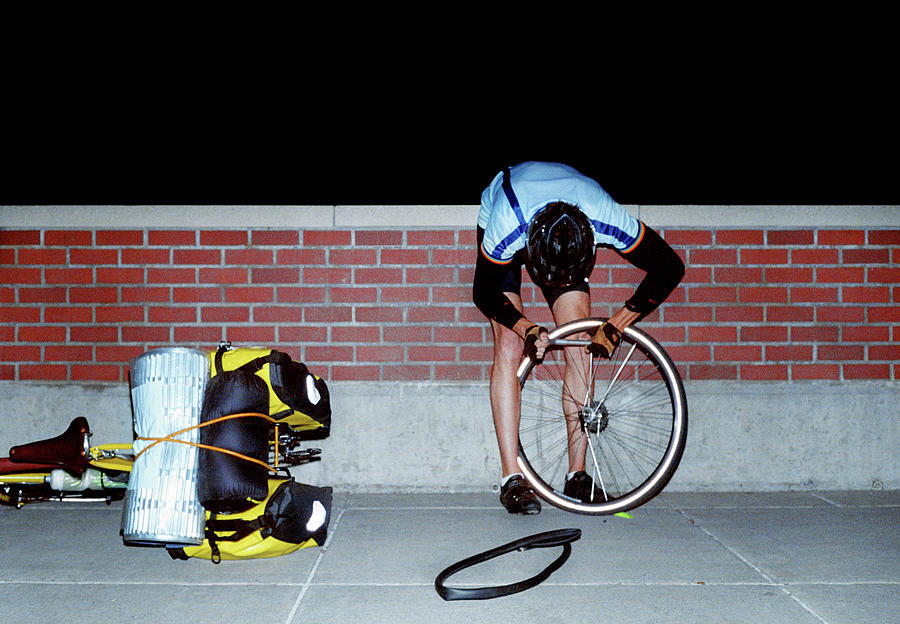 Cyclist Fixing Flat Tire Photograph by Brad Wenner